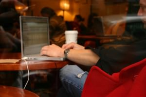 Man seated in cafe with laptop
