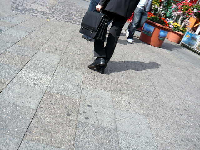 Businessman walking down street